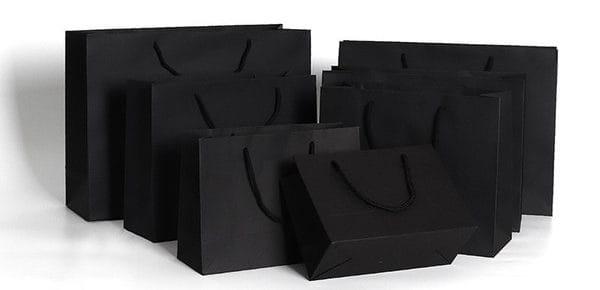 plusieurs sacs publicitaires noir