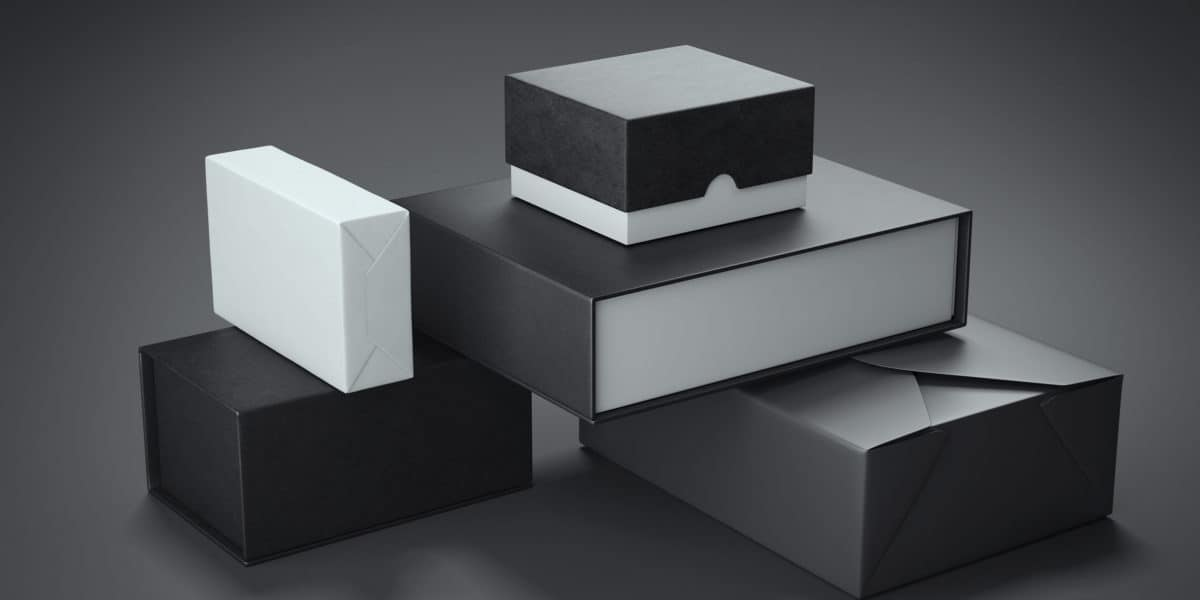 Different types of black boxes in dark studio. fournisseur-boite-personnalisable