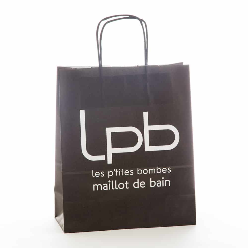 un sac kraft noir pour la marque de prêt à porter les petites bombes