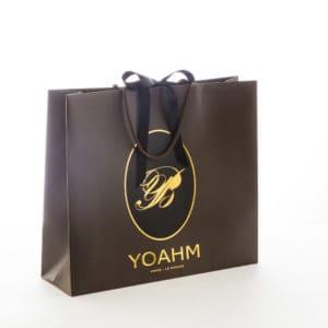 un sac papier personnalisé pour la boutique Yoahm