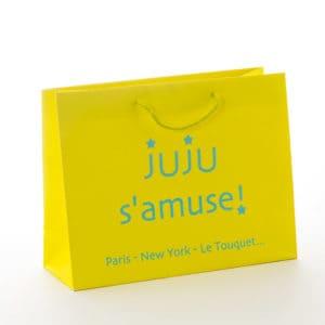 un sac kraft de luxe couleur jaune pour juju s'amuse